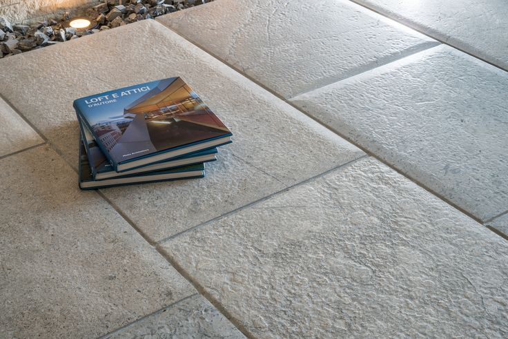 grey limestone floor with rounded edges.