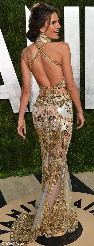 ALESSANDRA AMBROSIO IN A STUNNING SHEER GOLD EMBELLISHED HALTERNECK GOWN