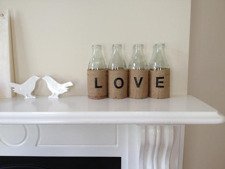 My husband did this for my Xmas present - old milk bottles with hessian cloth and stick on decal letters.