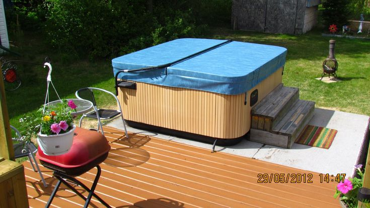 Gary sends in this great looking hot tub cover and lifter combo from The Cover Guy. www.thecoverguy.com