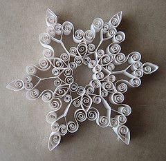 Paper Quilling. My Grandma taught me how to do this! Her snowflakes are priceless to me...