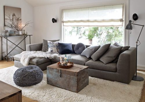 Warm up the charcoal couch with texture?