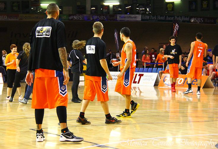 Southland Sharks' Leon Henry, Andrew Wheeler and Luke Martin watching the dancers hogging the court at half time - they didn't join in though? Stadium Southland, June 21, 2013. Southland Sharks v Otago Nuggets. Southland Sharks 115 - 67 Otago Nuggets.