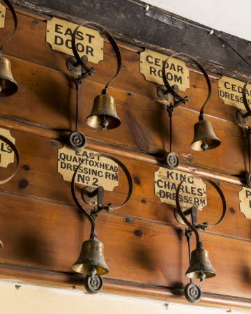 Servants' bells in the Bell Chamber at Dunster Castle, Somerset.