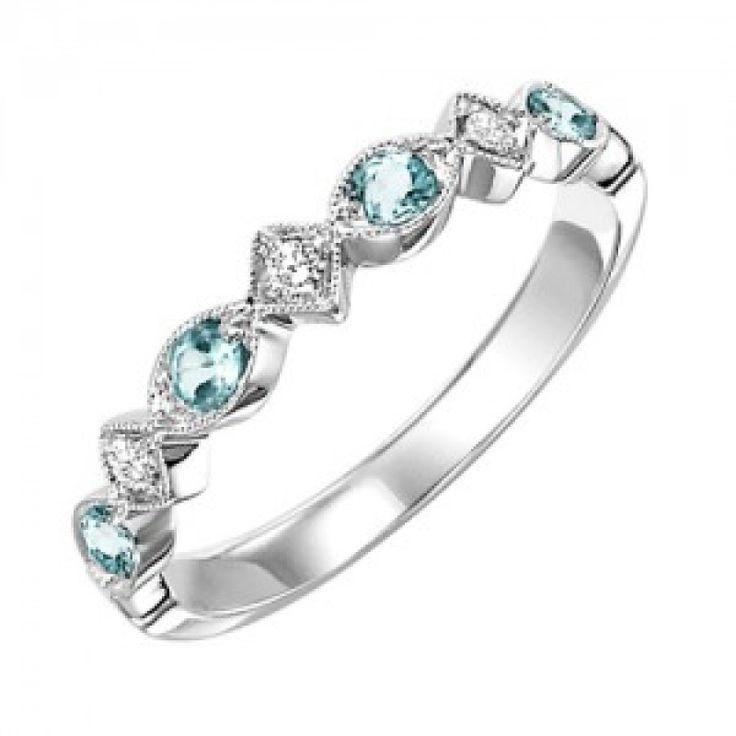 10k white gold diamond and blue topaz birthstone ring