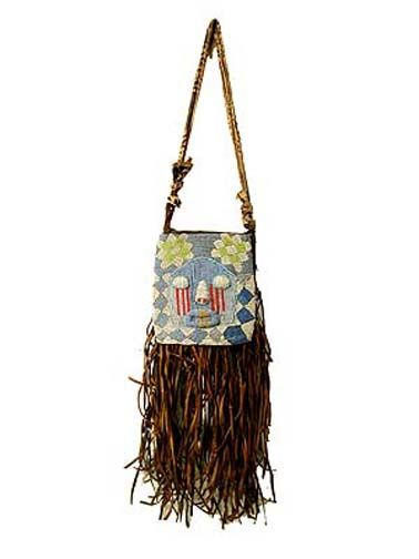 Used to carry divination objects and tools, the bags are worn in public ceremonies by Ifa priestesses and used and displayed in their homes. Beads were signs of wealth and status. The beaded front lifts up to reveal a pouch on the back panel