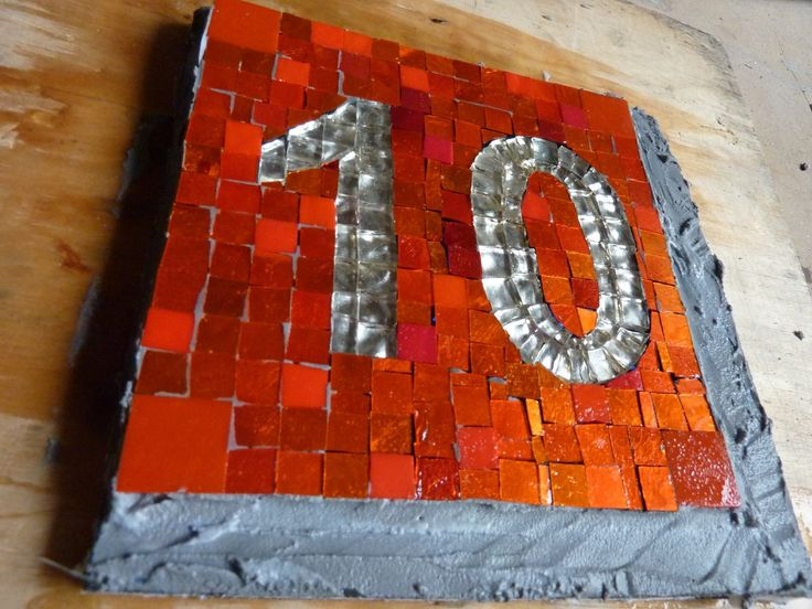 number 10 in 24Kt. Gold-tesserae (almost finished !)  returned and glued on final fixation-panel, now 24 hours drying and then final grouting + cleaning and fine-tuning board