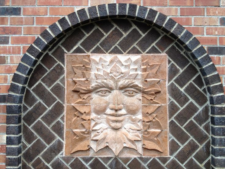 Green man created by Mara Smith, placed in our garden wall by stonemason Dennis Adair, who did all the brickwork on the garden, fountain, and greenhouse.