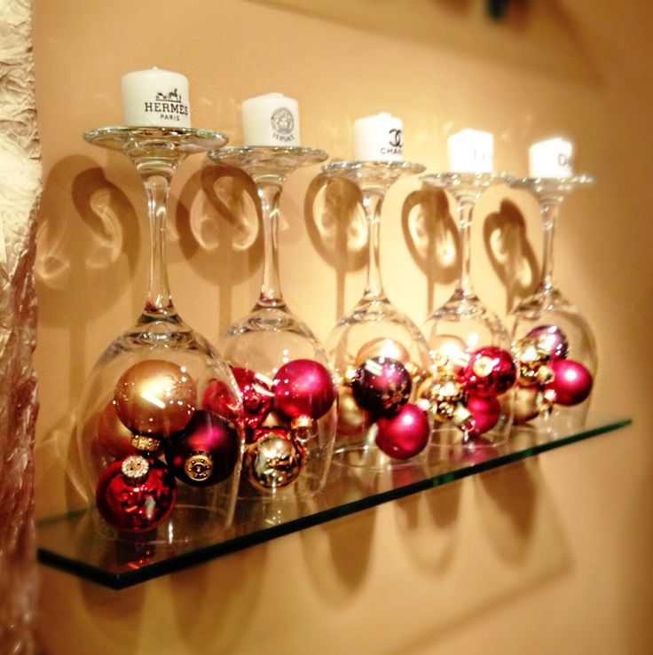 Christmas Decor-upside down wine glasses.filled w small ornaments.candles on base