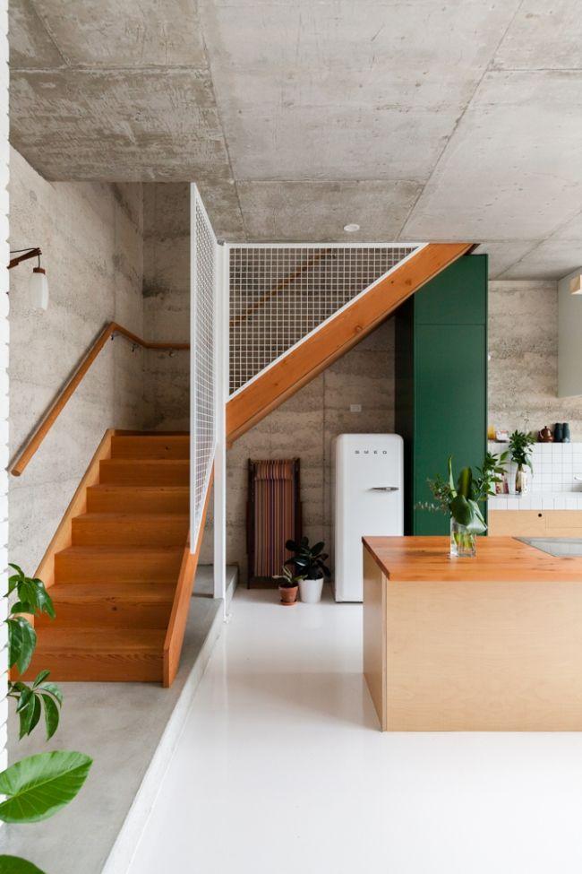 smeg fridge, concrete walls, the balustrade.
