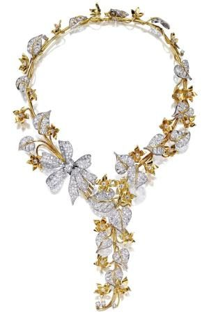 18 KARAT GOLD, PLATINUM AND DIAMOND NECKLACE AND BRACELET, DESIGNED BY GEORGE HEADLEY, LOS ANGELES; THE NECKLACE RETAILED BY PAUL FLATO, CIRCA 1941. The flexible necklace designed as a graduated line of flowering vines accented by an off-set diamond bow, the leaves and bow set with old mine and old European-cut diamonds weighing approximately 30.10 carats by hester