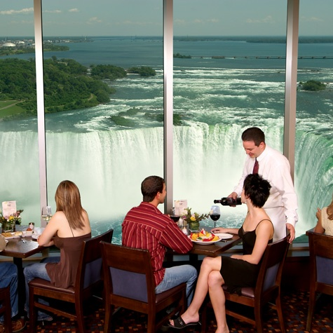 View of Niagara Falls from your table at the dining room of the Keg Steakhouse & Bar in Niagara Falls, Canada located in the Embassy Suites by Hilton Fallsview. Hotel Getaway Fallsview Dining Packages are available!