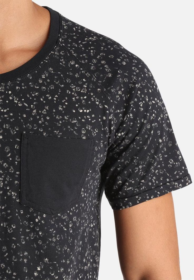 Footprints, leopard spots – whatever your personal choice, this all-over spotty tee ups the ante with a super soft cotton construction, scoop neckline and regular fit. Pair it with just about any bottoms, from chinos to jeans or pool shorts – but opt for more basic options to avoid going OTT. Sneakers will complete the duo.