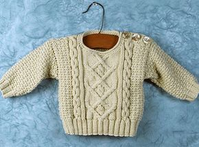 A mini version of our woman's pullover Poonam, Baby Poonam is an aran pullover with buttoned shoulder.