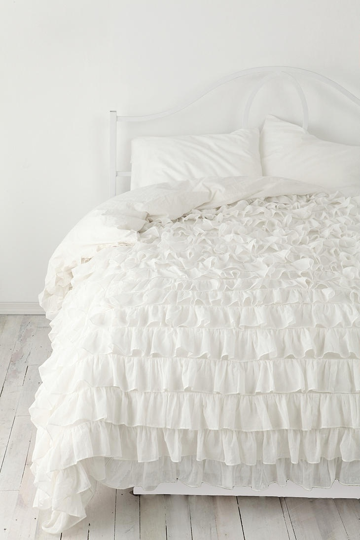 White bedding.. risky, but it would look amazing against a navy wall! Waterfall Ruffle Duvet Cover #UrbanOutfitters