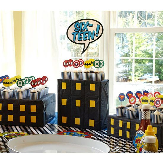 Real Mom: Julie of Less-Than-Perfect Life of Bliss Real Party: Superhero 16th Birthday A palette of primary colors set the stage for Julie's throwback superhero party. We love her easy superhero DIYs, including a city-skyline photo backdrop complete with hero masks and speech bubbles. Pow!/