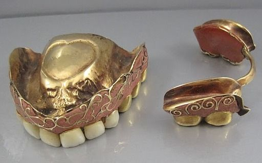 Antique enameled and filigree gold false teeth. Origins unknown.