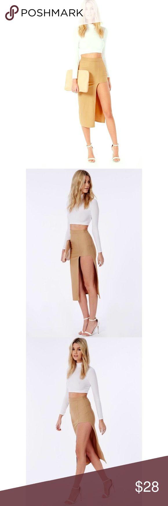 "Misguided asymmetric split midi skirt camel this camel asymmetric midi skirt has a real play on lengths with a mini skirt side split cut out detail. in a stretch crepe fabric this figure hugging skirt is sure to turn heads. style with a lace bralet and skyscraper barely there heels for smokin' hot styling.  approx length 81cm/32"". Machine washable size us. 6 worn once Missguided Skirts Asymmetrical"