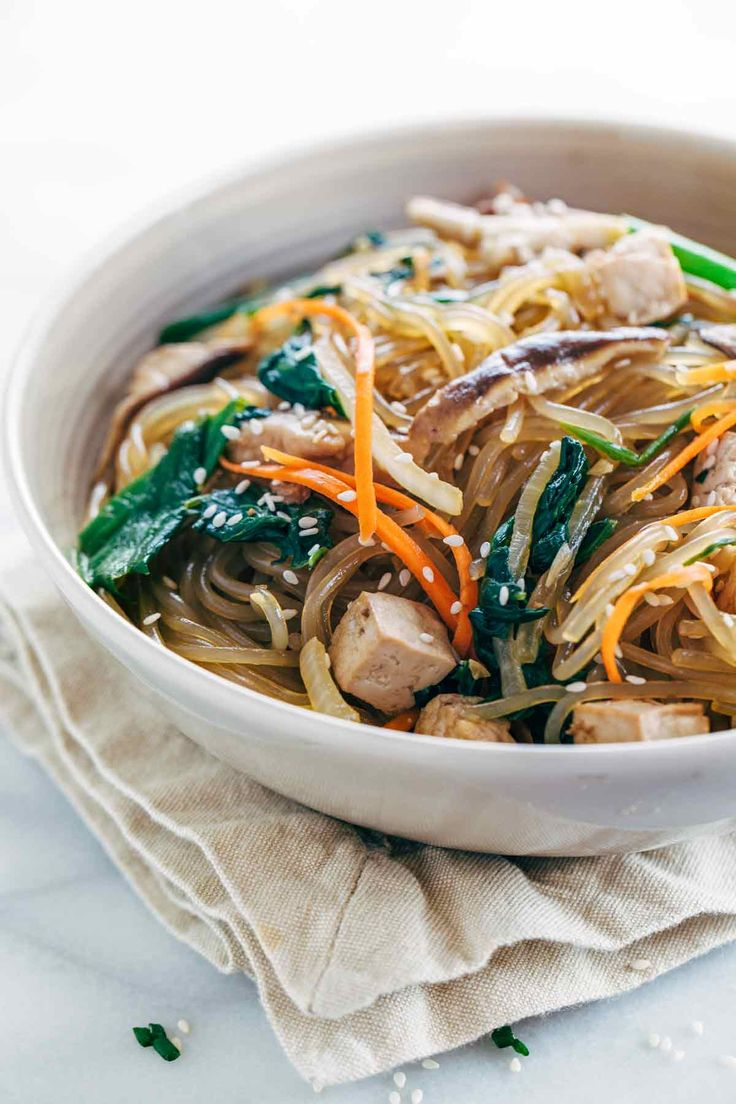 Japchae Korean Glass Noodles with Tofu - Each bite is packed with healthy vegetables and plant protein for a delicious gluten free meal.   jessicagavin.com