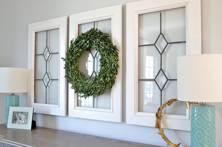 If you can't find these leaded glas windows, find a single panel window for cheap at a local antique mall and recreate the design. Simply use the faux leaded stainedglass paint to draw in the vintage leaded glass panes. Then hang with boxwood wreath for this look. I think it would look great with a single window turned sideways and the wreath added.