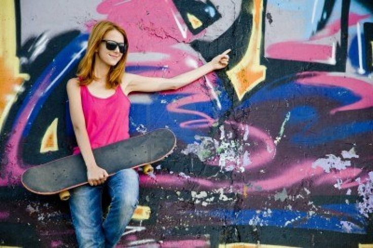 http://us.123rf.com/400wm/400/400/massonforstock/massonforstock1109/massonforstock110900143/10663607-style-girl-with-skateboard-near-graffiti-wall.jpg