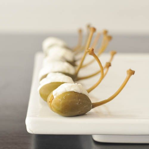 Goat Cheese Stuffed Caper Berries... drop it in a dirty martini and look ultra fancy in a flash.