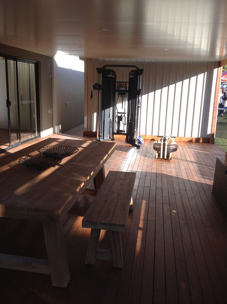 Calyn has direct level access to the entertaining deck.Table and  Bench Nick Scali. Gym Elite Fitness