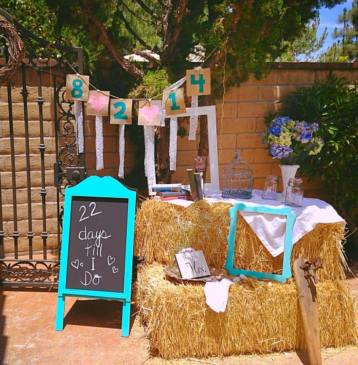 Hay bales, painted frames, banner & chalkboard = a cute set-up for a cute vintage bridal shower