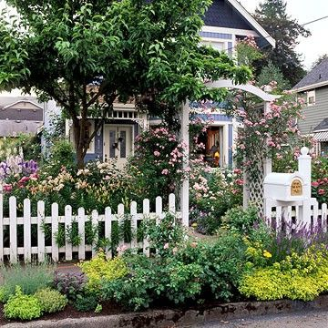 There's a little gem of a Queen Anne cottage in there, nearly buried in a tumble of flowers