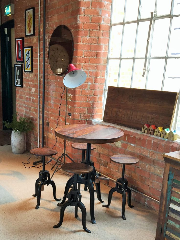 Our Hyatt - Fulton Industrial Height Adjustable Crank Table and Stools are pure genius! Their heights are adjustable, so you can choose to have it as a café table set, or crank it up to a bar table with bar stool!