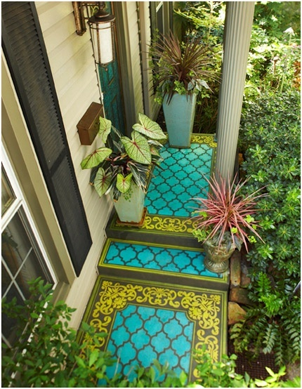 Stencil on concrete. Vibrant colors in an unexpected corner of the backyard or garden liven up everything else.