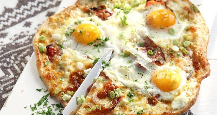 Pizza with eggs and bacon