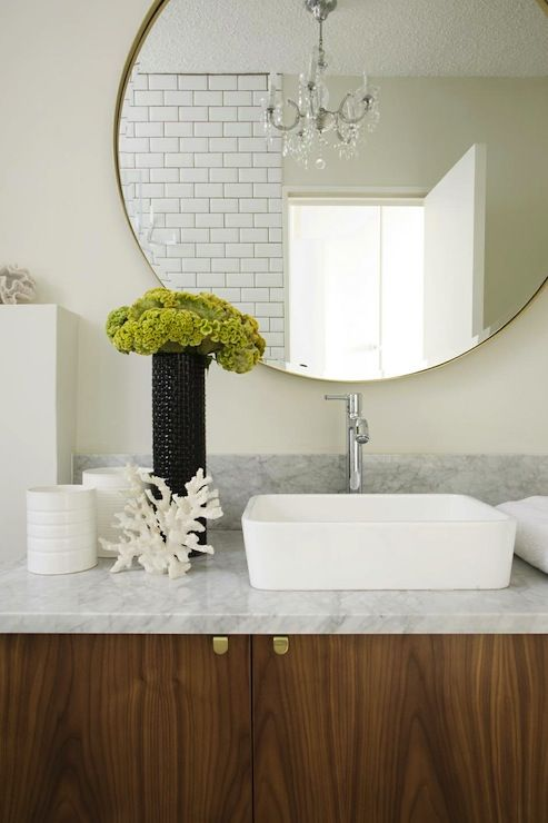 Beautiful Bathroom Veneer Cabinets With Brass Hardware And White Carrara Marble Countertops