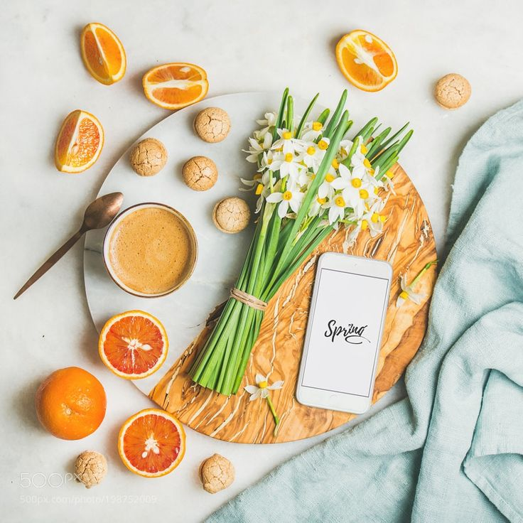 Coffee cookies oranges flowers and mobile phone with word Spring by 2enroute