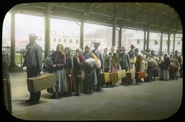 April 17, 1907: Ellis Island experienced its highest volume of immigrants processed, at 11,747.  Immigrants in Line at Ellis Island, colored lantern slide, Transparency File, PR 070-1-84-1.  New-York Historical Society, 83069d.