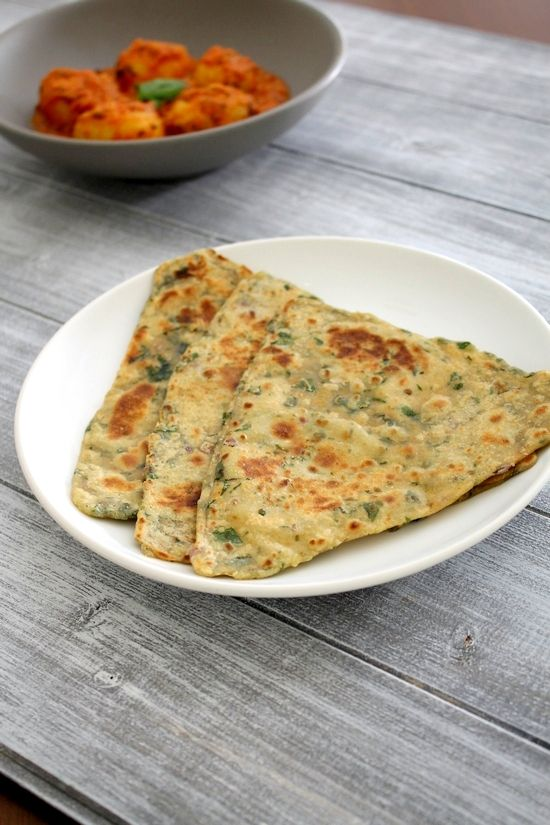 Palak paratha recipe with step by step photos - very healthy and flavorful spinach paratha recipe. This is good for kids and people who hate spinach.