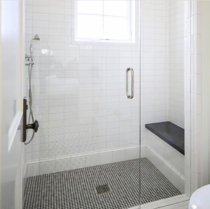 We could use the marble mosaic tile with black accents that you have from can as your master shower floor. White subway and use black honed granite for a bench top.