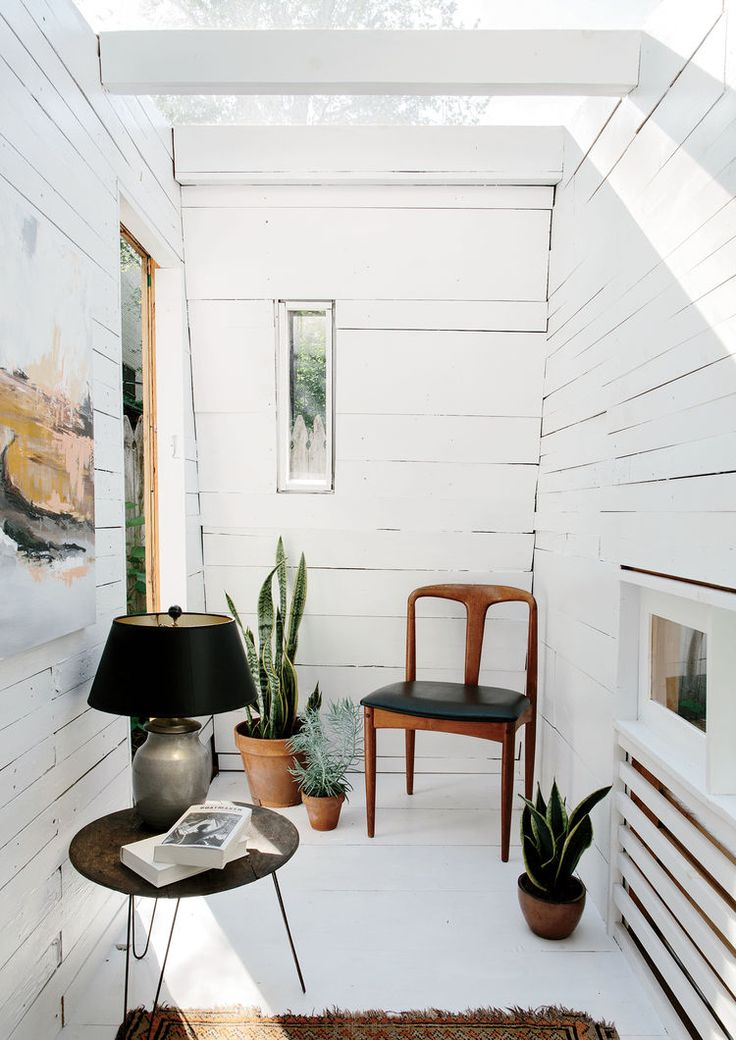 Modern Brooklyn backyard studio with plexiglass skylight, green roof, and cedar cladding interior