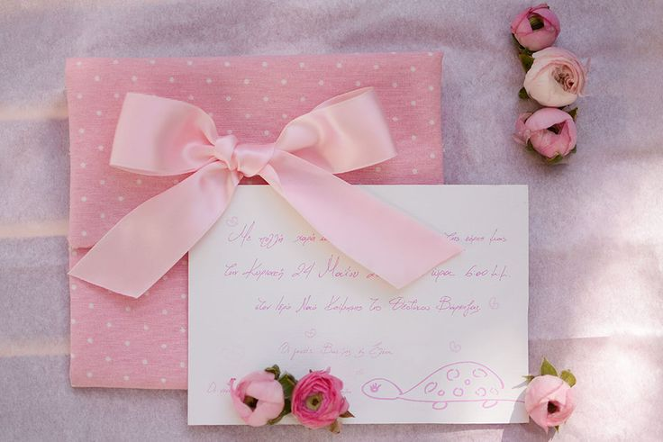 Super girly baptism invitation in hand lettering with cute drawings in polka dotted envelope