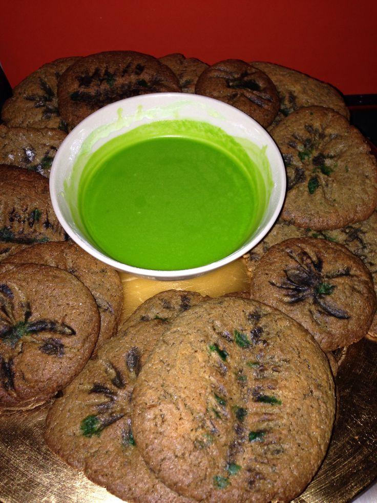 Cookies imprinted with plastic spiders or bugs. Dip is coloured icing.  Fossils and slime dip