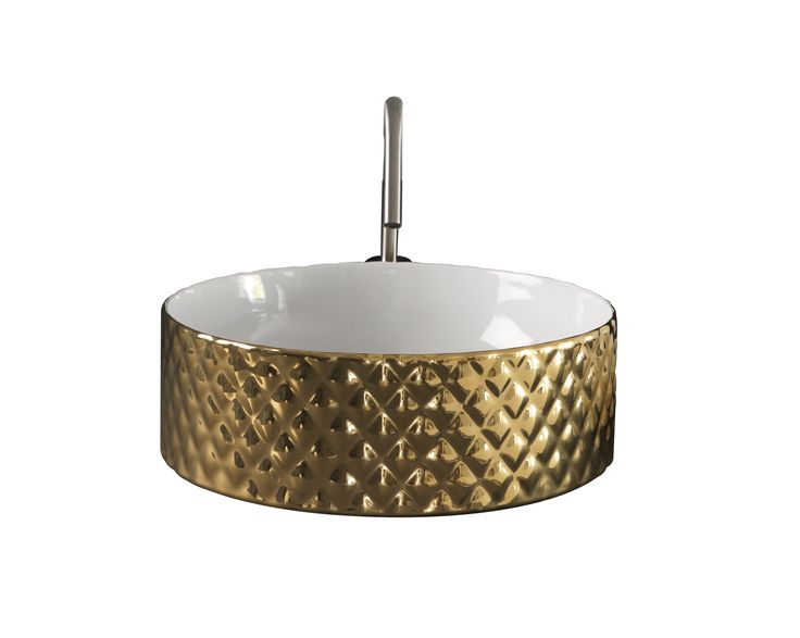 Rombo washbasin in gold finishes. Gold and platinum finishes represent new luxury styles on minimalism and elegant environments where fittings and accessories are the main focus not just superfluous, baroque elements.