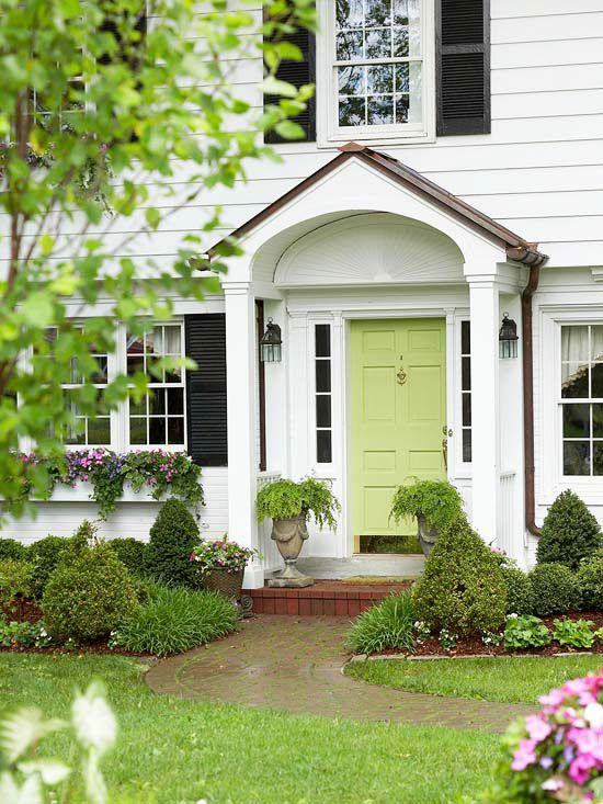 Make the Point of Entry Pop: A punch of bright, bold paint that contrasts with the siding and trim is an easy way to revamp a tired entry. Against the white facade, this spring-green door cheerfully leads visitors inside. Consider the style of your home and choose colors accordingly.