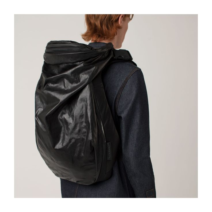 In a world where rucksack design seems to be preoccupied by either nostalgia or disposability, the organically shaped Nile rucksack from côte&ciel offers a rare and progressive silhouette. Expertly designed and crafted with functionality foremost in mind, the freeform shapes is designed to sit comfortably against the lower back while providing ample safe storage for your everyday tech  - and boasts enough capacity to easily double up as a weekend bag.