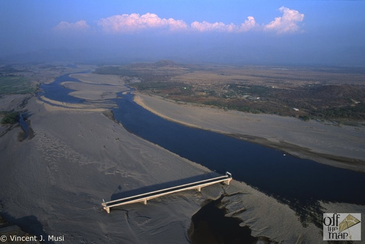 Choluteca Bridge in Honduras. In November 1998, Hurricane Mitch ravaged the Honduras. 5,600 people died. 12,300 were injured and 8,600 disappeared. In addition to the loss of human life, 150 bridges were damaged or destroyed. The most modern of all the bridges, The Choluteca Bridge survived intact but suffered perhaps the greatest indignity, the river moved right out from under it leaving its builders wondering what to do next.  This bridge was the only bridge left standing after the storm…