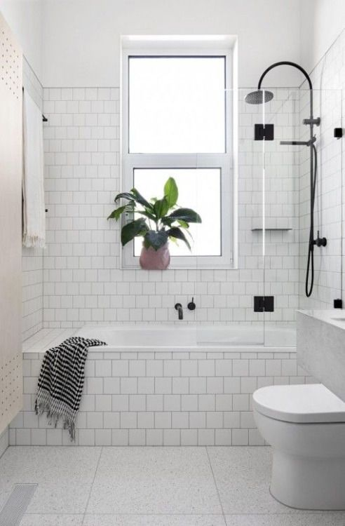 Love but small tiles just on the walls. Solid white around tub