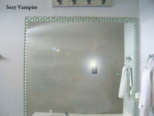 this is a good one......Vampire taking FB Pic!