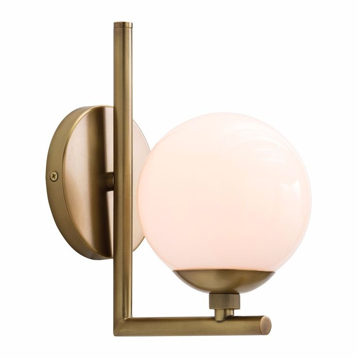 """An antiqued brass single sconce with a frosted glass globe that rests on an L-shaped arm. - Dimensions: 8""""L x 5.5""""W x 10""""H - Materials: Steel; Glass - Finish: Antiqued Brass; White Frosted - Backplate"""