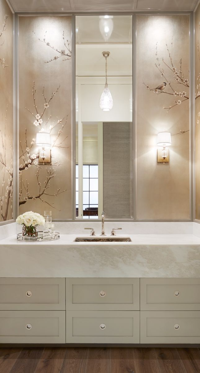 White glamorous luxe bathroom with narrow tall mirror | Rivera Fine Homes