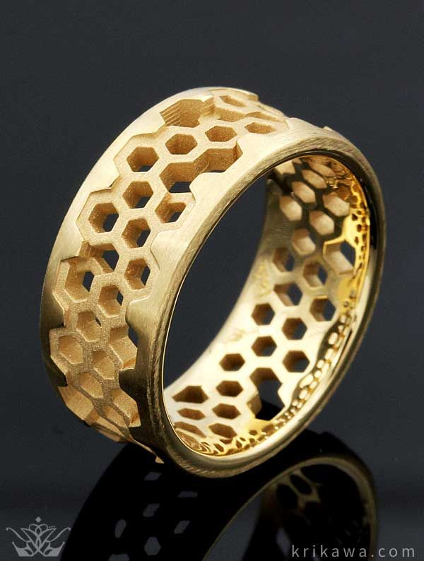 Unique Mens Wedding Band - Hex Wedding Band. This geometric wedding band is comprised of hexagons. This six-sided polygon is evocative of honeycombs and the molecular level. The shapes are cutout and overlap each other, creating an intricate pattern.