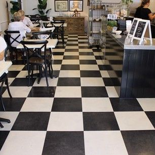 Stunning black & white Checkered floors, French Colonial style at The Island Cafe in Bundall. by @evolvedluxuryfloors (Evolved Luxury Floors)